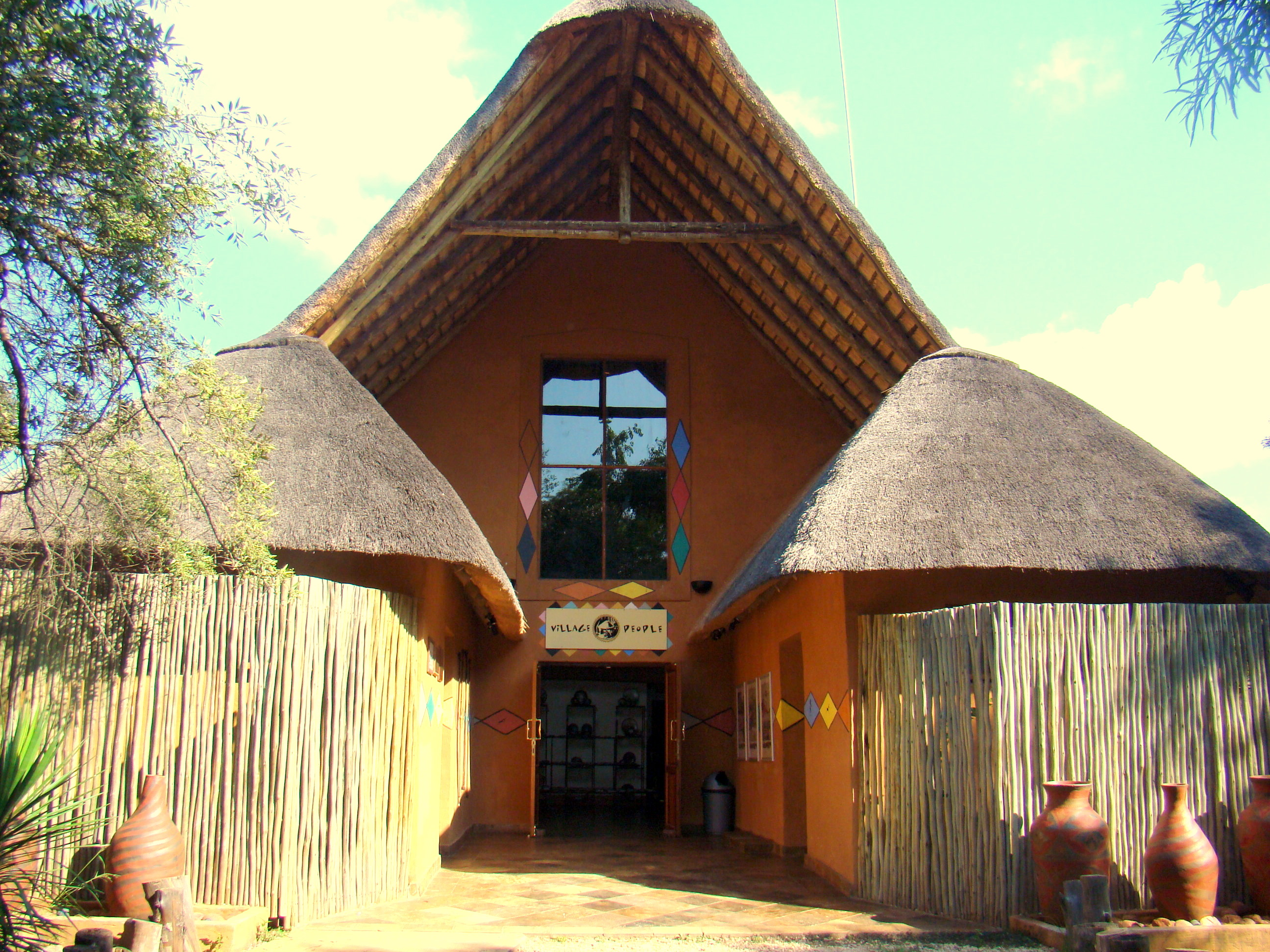 Traditional african houses images for Photos of traditional houses